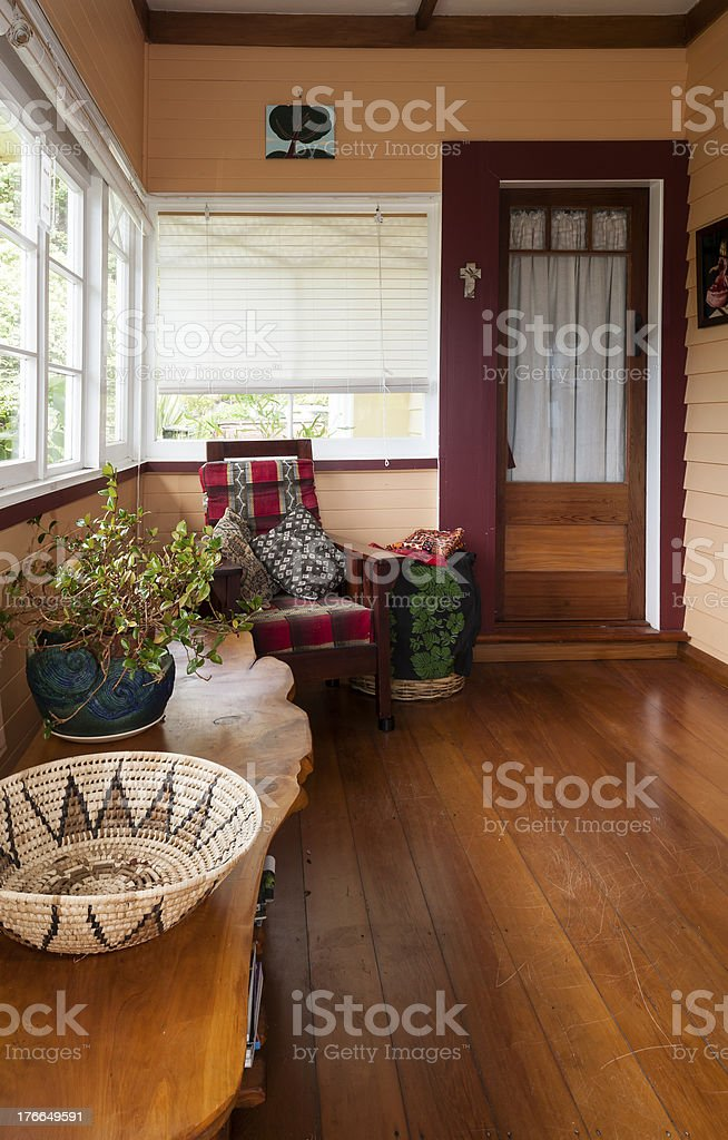 Sun room in 1920s bungalow with vintage arm chair royalty-free stock photo