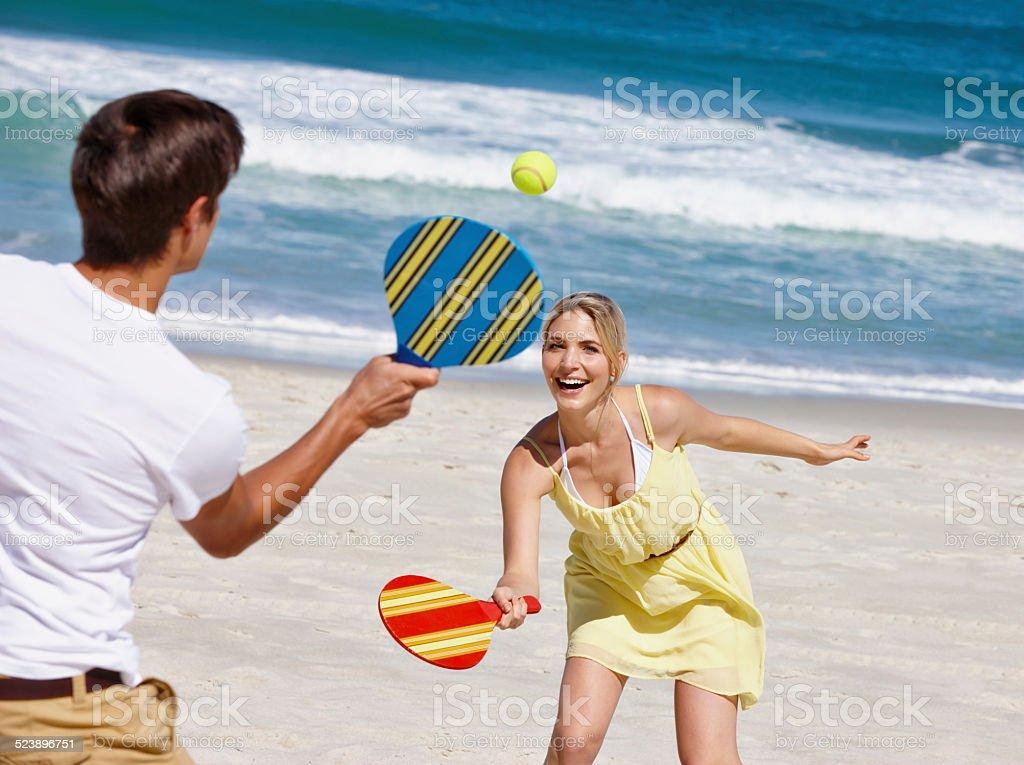 Sun, sand and paddle ball! stock photo