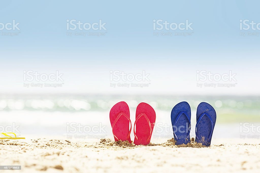 Sun, sand, sky, sea, surf, sandals: the perfect summer holiday! stock photo