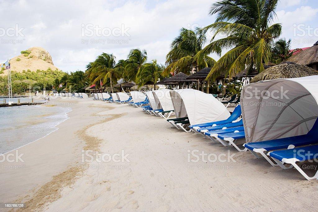 sun sea and sand; beach resort in paradise stock photo
