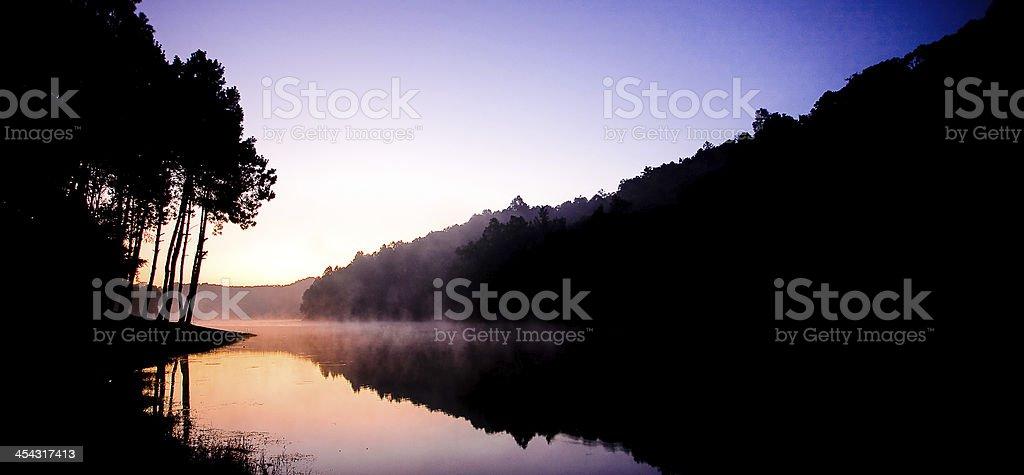 Sun set on lake royalty-free stock photo