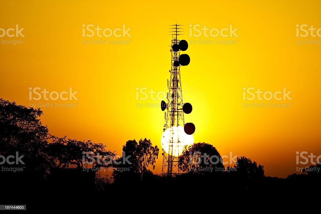 Sun sets behind African telecoms tower stock photo