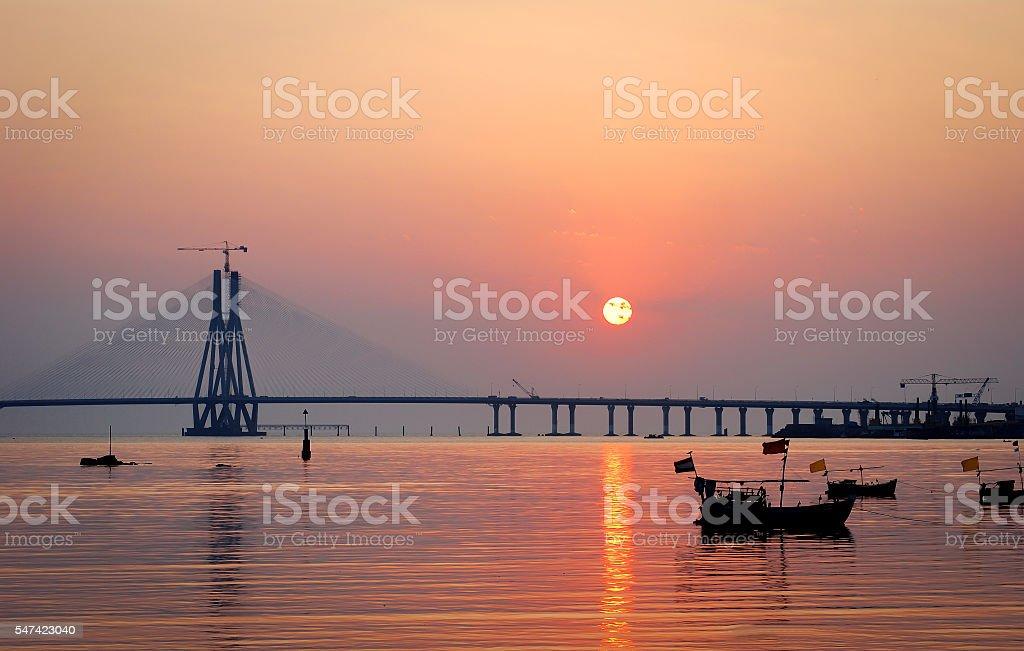 Sun sets behind Bandra-Worli Sea Link stock photo