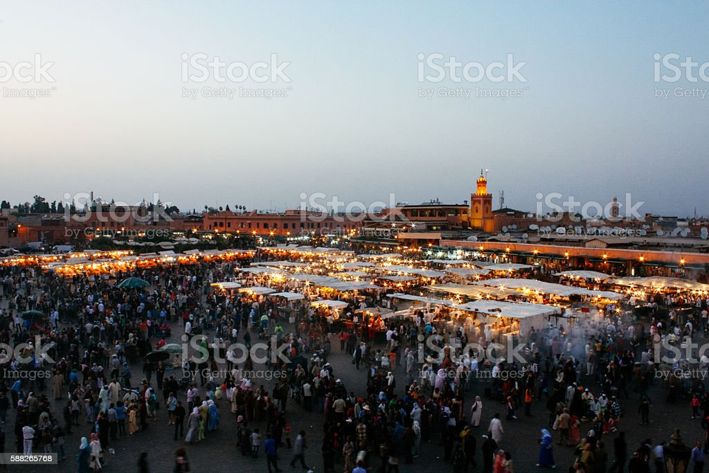 Sun sets on busy Jemaa El Fna square, Marrakech stock photo