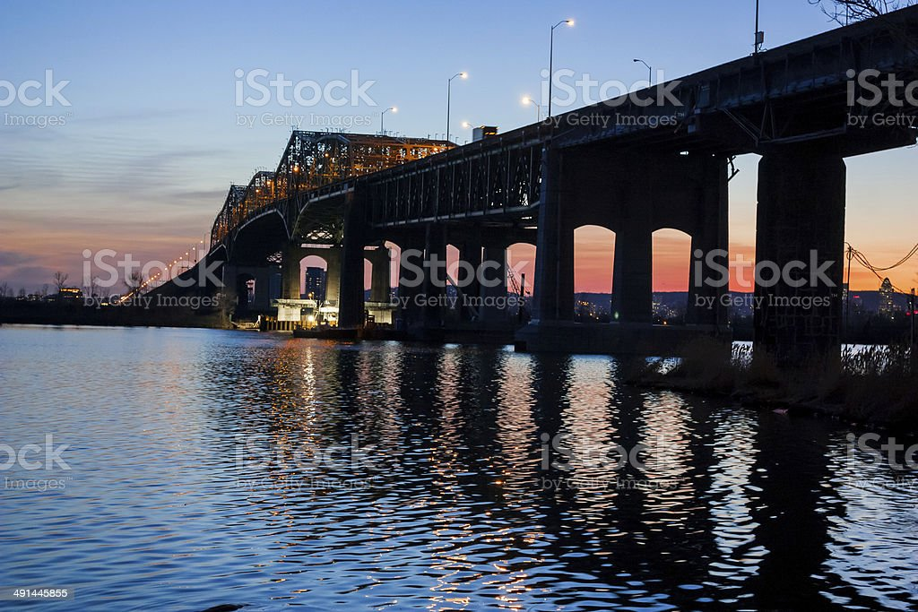 Sun sets on the Champlain bridge stock photo