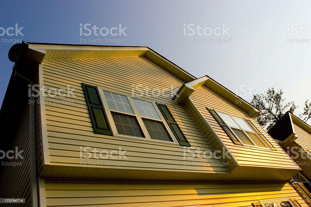 Sun setting on house royalty-free stock photo
