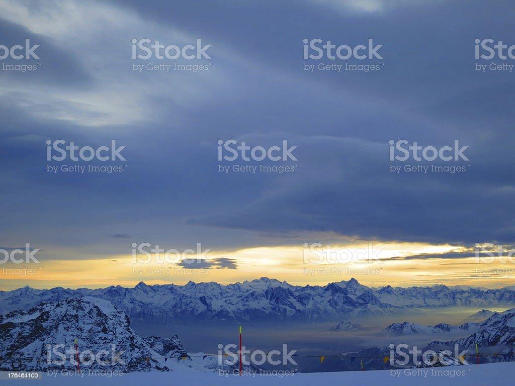 Sun setting on the Swiss Alps royalty-free stock photo