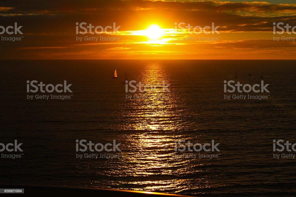 Sun setting on Waikiki royalty-free stock photo
