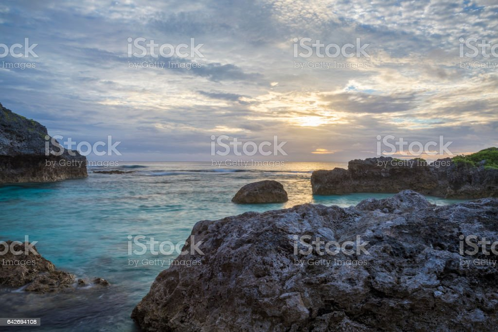 Sun setting over a tropical limestone reef stock photo