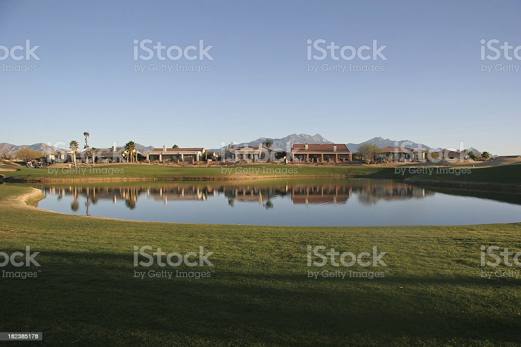 Sun Setting Over Homes On The Desert Golf Course royalty-free stock photo