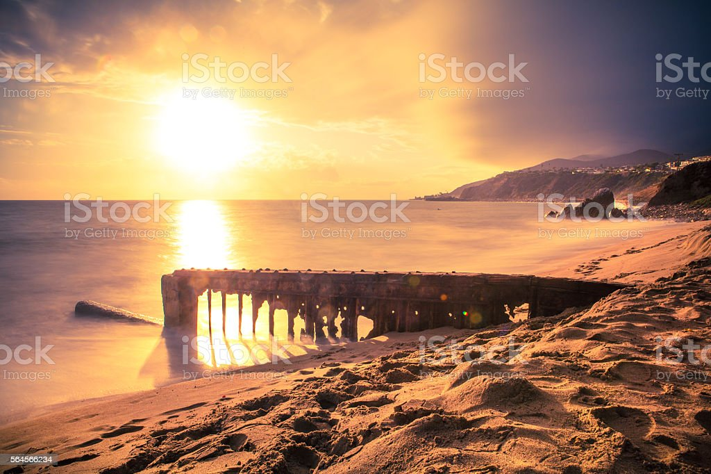 Sun setting over Santa Monica Bay, Decaying Beach Groyne Structucture royalty-free stock photo