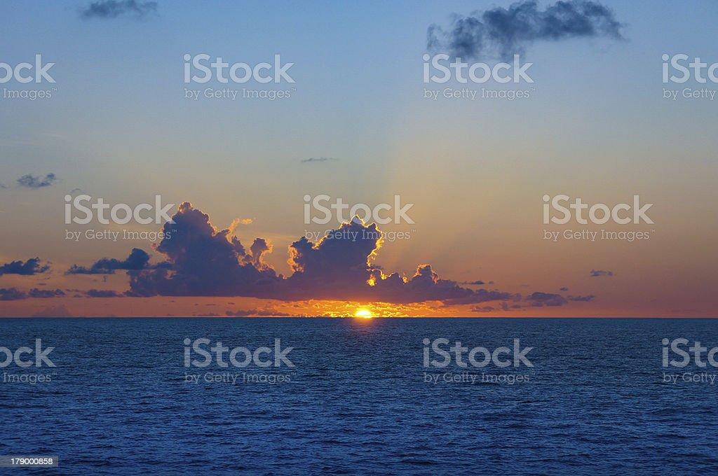 Sun setting over seascape, Arabian Sea, India stock photo
