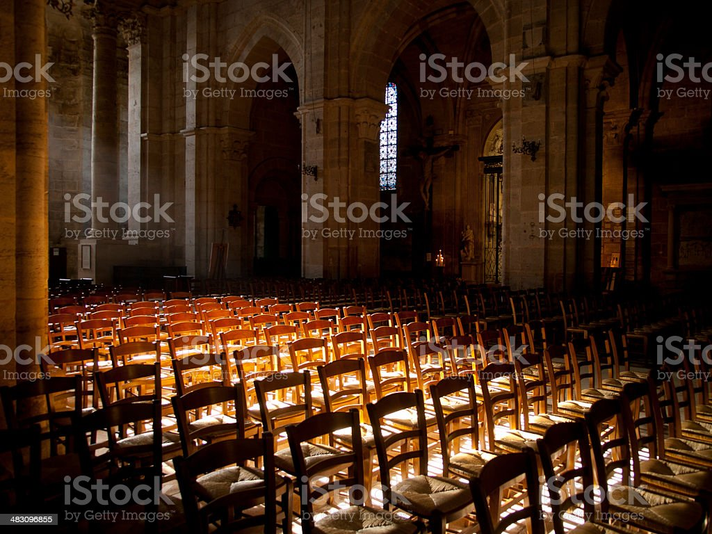 Sun shines inside an empty church in France royalty-free stock photo