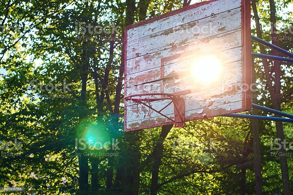 Sun shines through an old basketball shield stock photo
