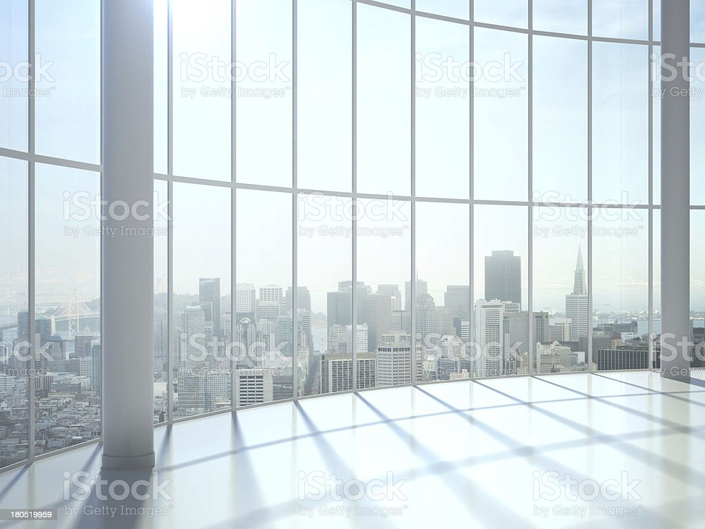 Sun shines through large window with view of city stock photo