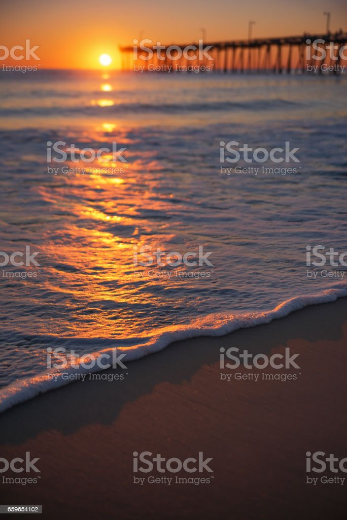 Sun shining across the water stock photo