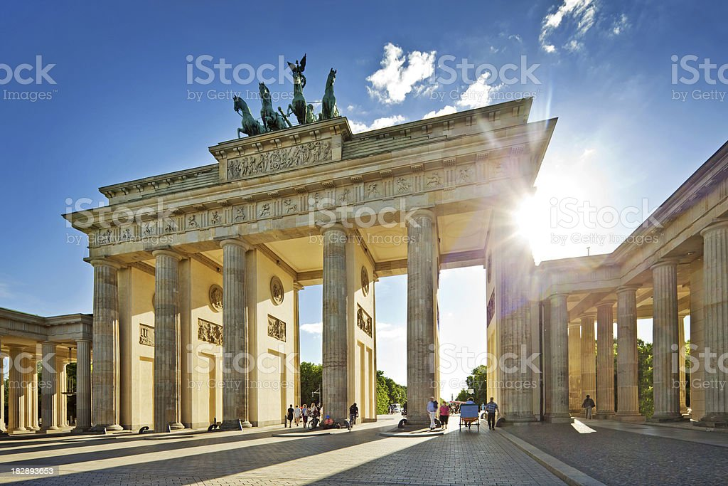 Sun shining through Brandenburg Gate in Berlin stock photo