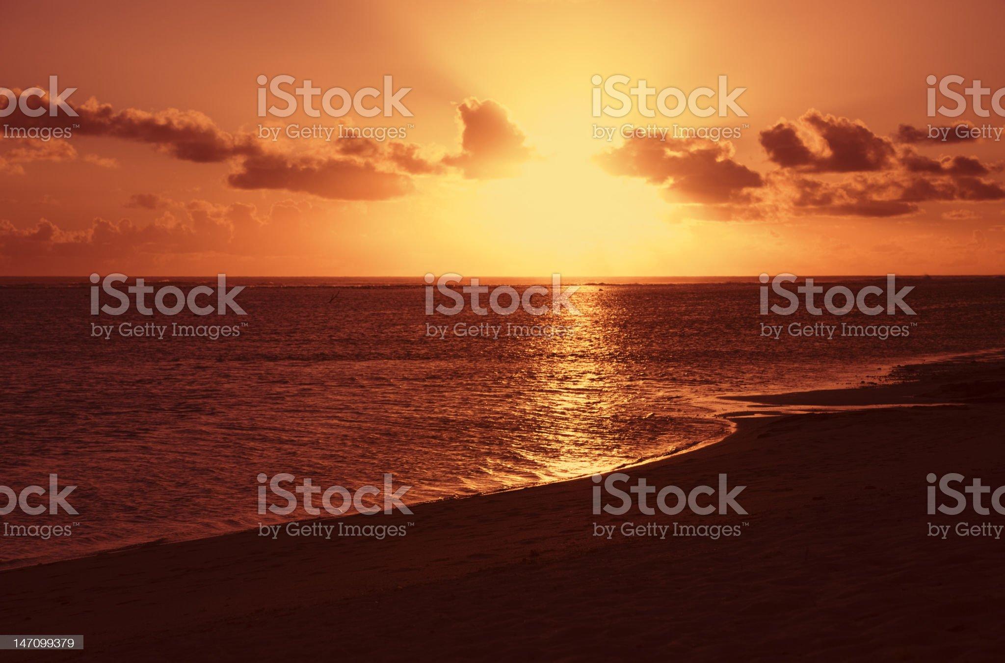 Sun shining through Clouds at Sunset royalty-free stock photo