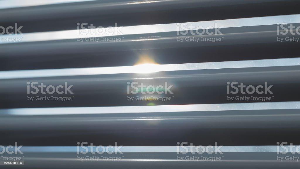Sun shining through the blinds stock photo
