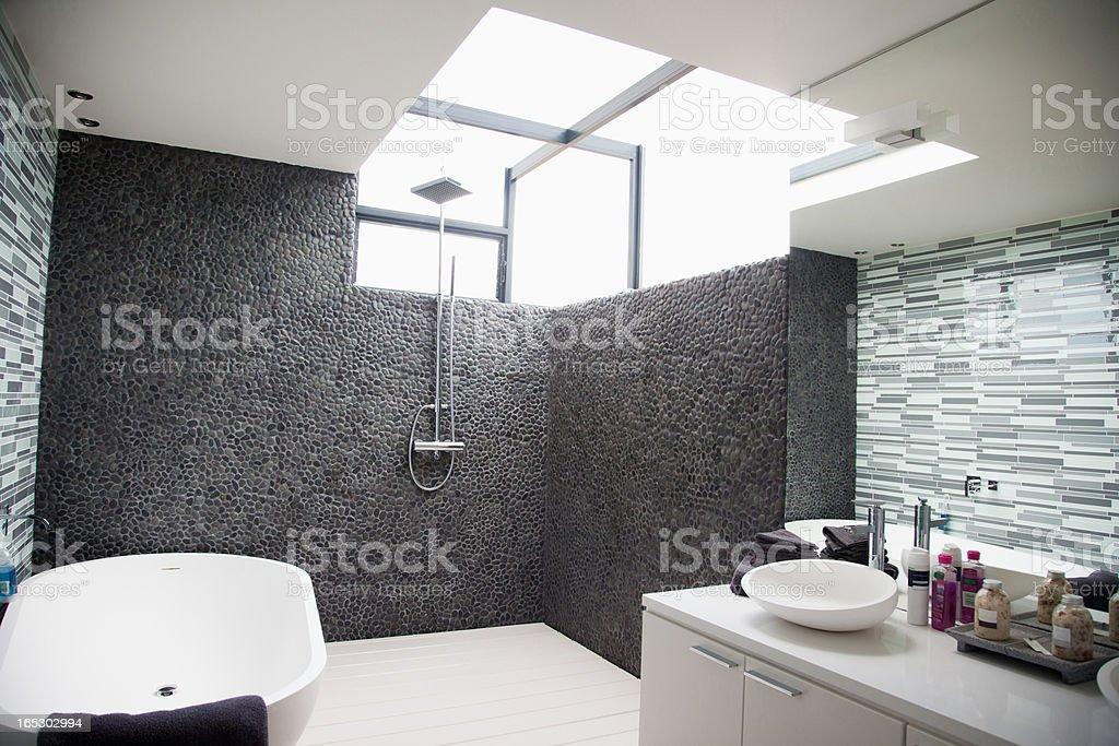 Sun shining through window in modern bathroom royalty-free stock photo