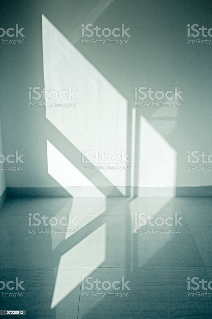 Sun shining through window on wall stock photo