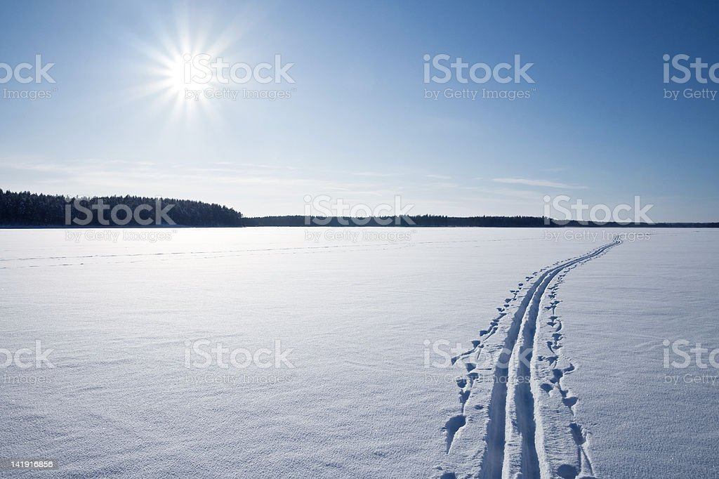 Sun, snow and Ski track stock photo