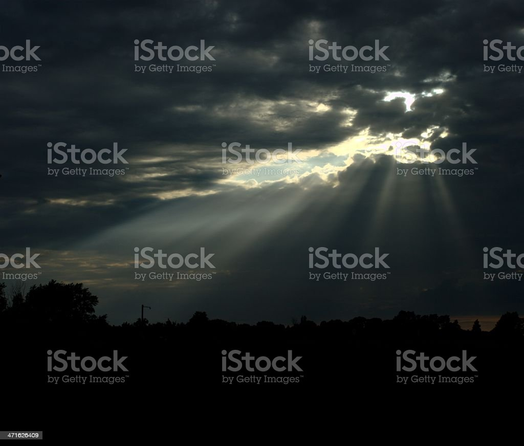 Sun through dark clouds royalty-free stock photo
