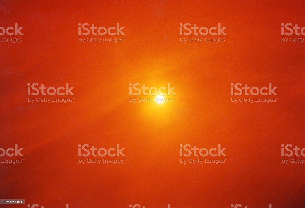 Sun through orange filter stock photo