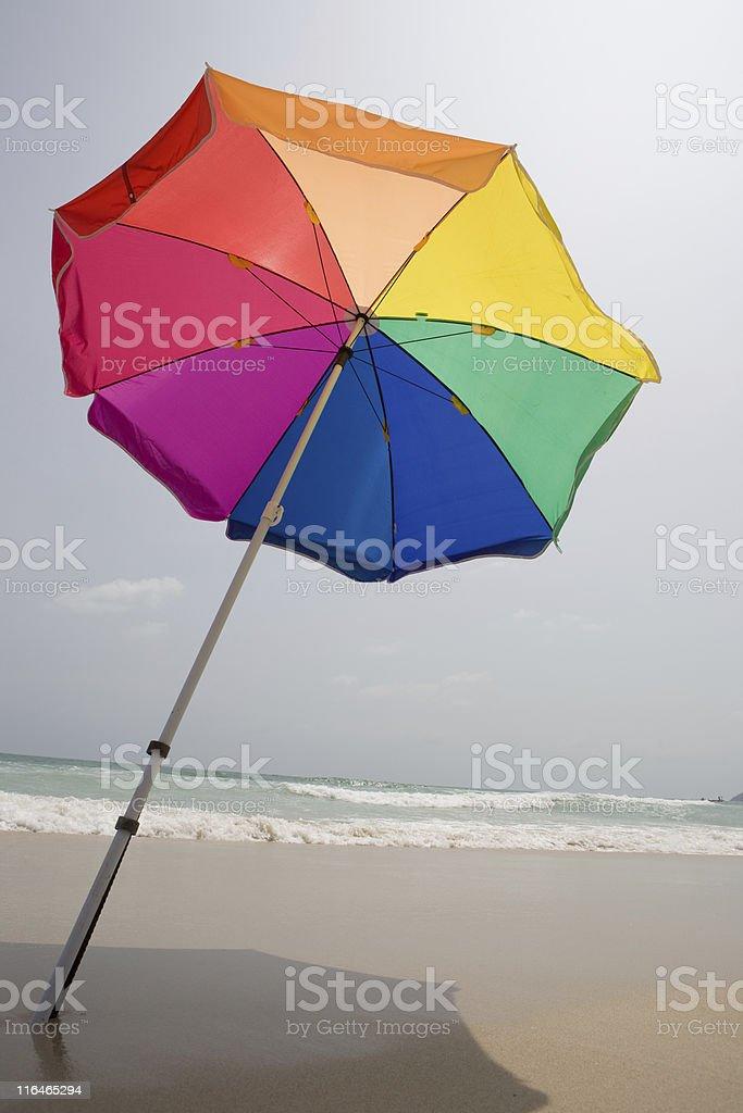 Sun umbrella on the beach royalty-free stock photo