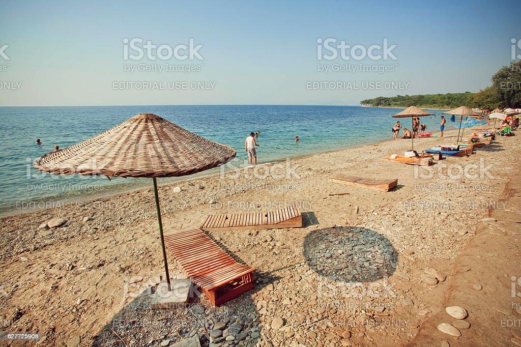 Sun umbrellas and people swimming in sea stock photo