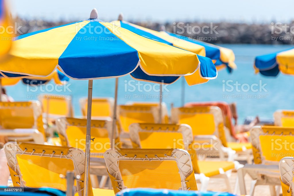 Sun umbrellas at sunny beach stock photo
