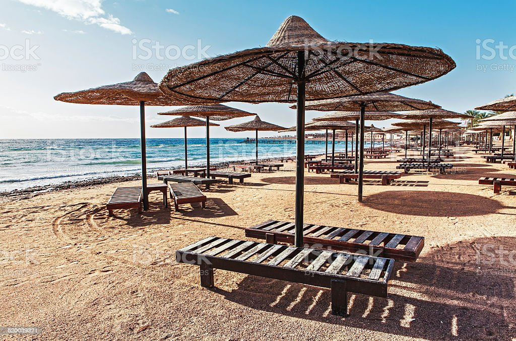 sun umbrellas on taba beach stock photo
