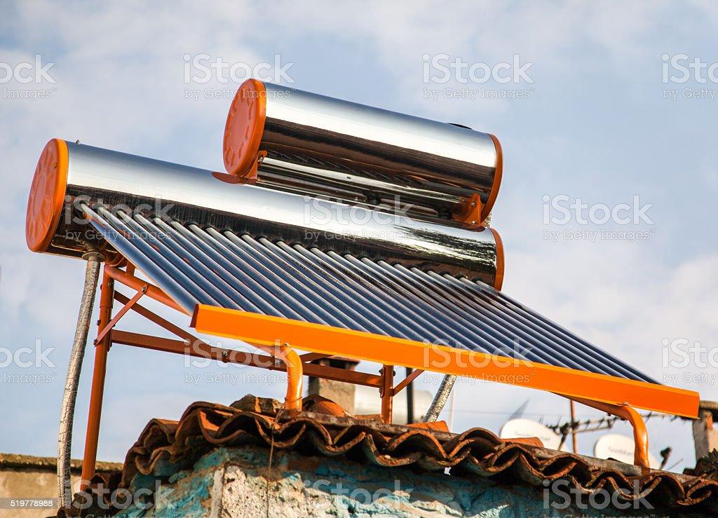 Sun Water heating system stock photo