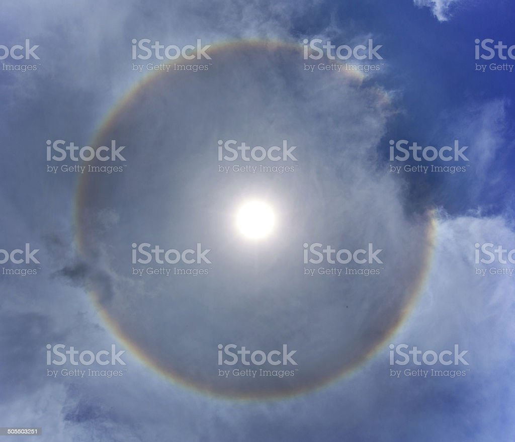 Sun with circular rainbow stock photo