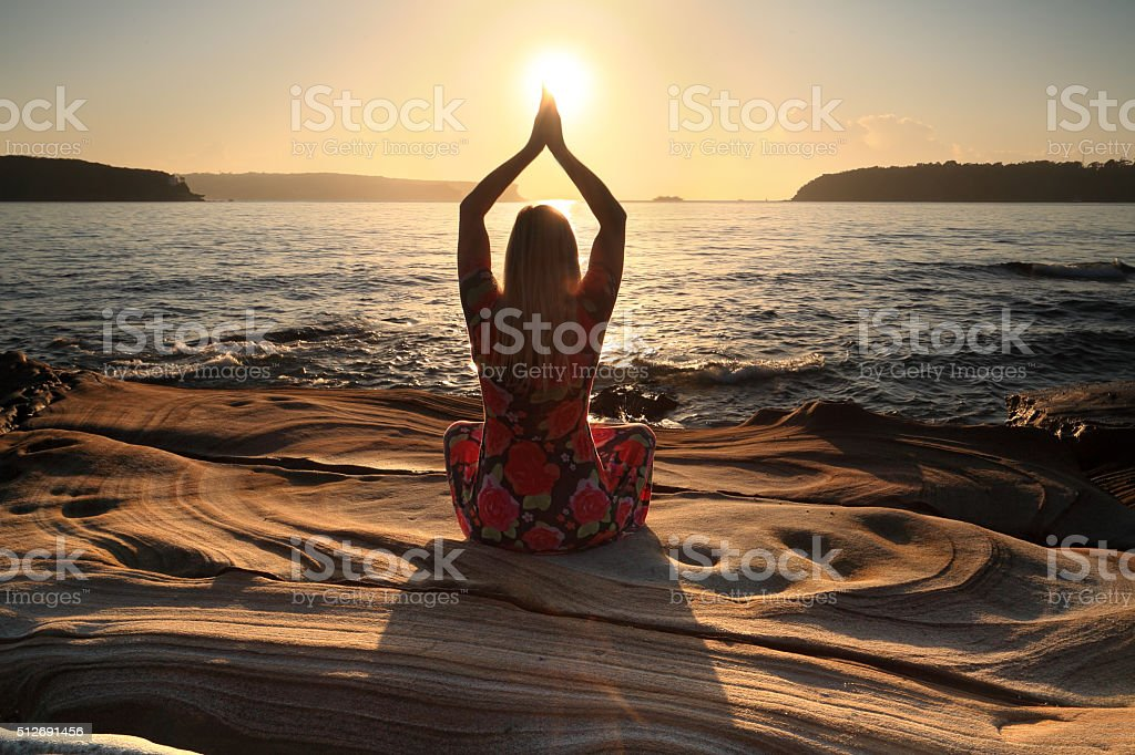 Sun worshipper, beach life, yoga by the sea stock photo