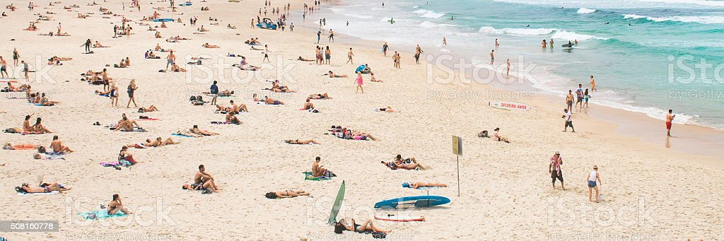 Sunbathers at Bondi Beach, Australia. stock photo