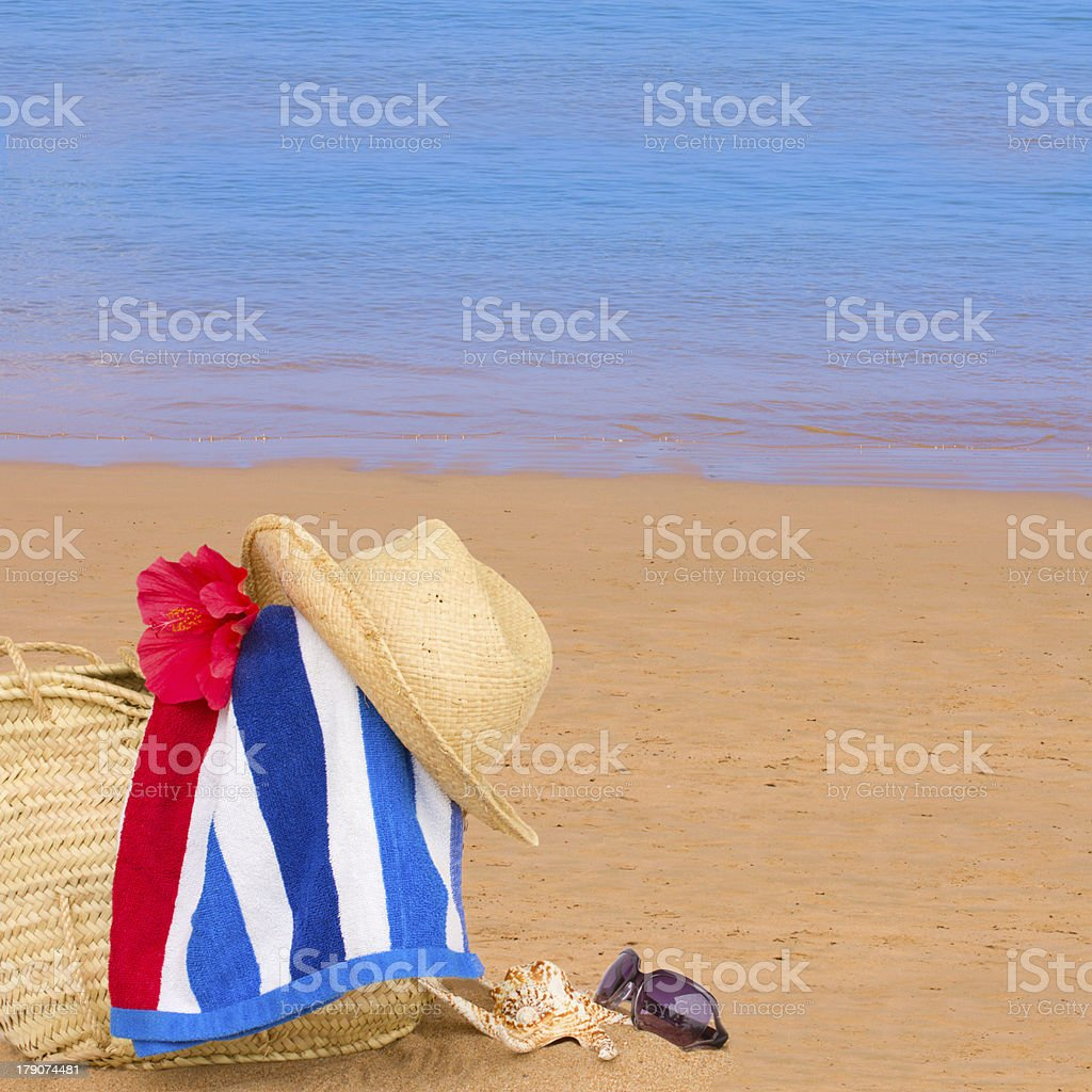sunbathing accessories at sea shore royalty-free stock photo