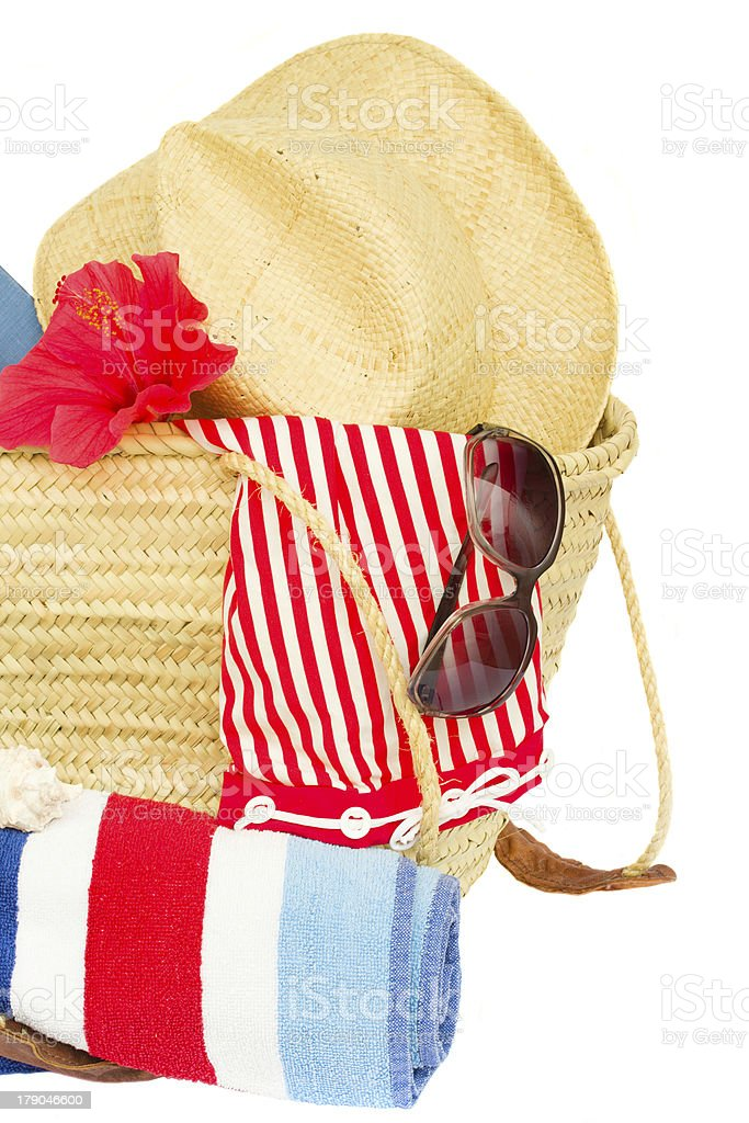 sunbathing accessories in straw bag royalty-free stock photo