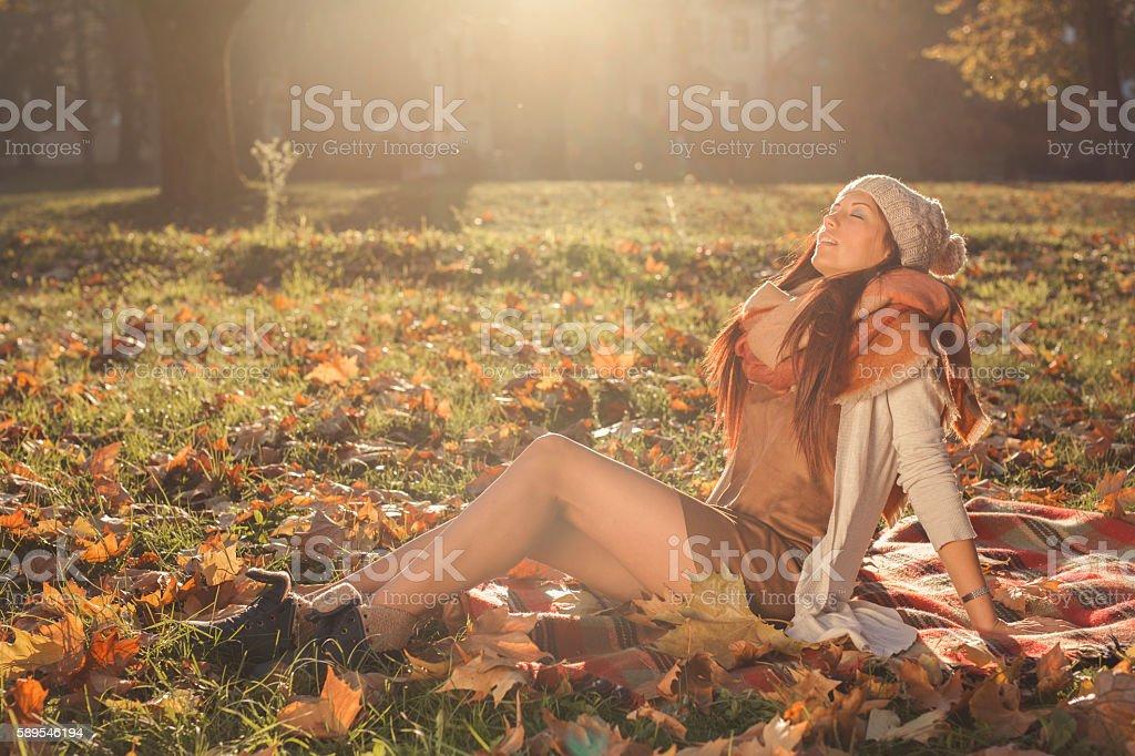 Sunbathing in the autumn stock photo