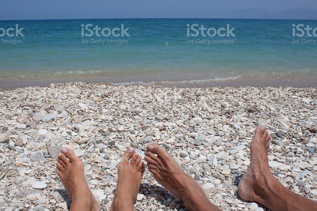 Sunbathing on a beach royalty-free stock photo