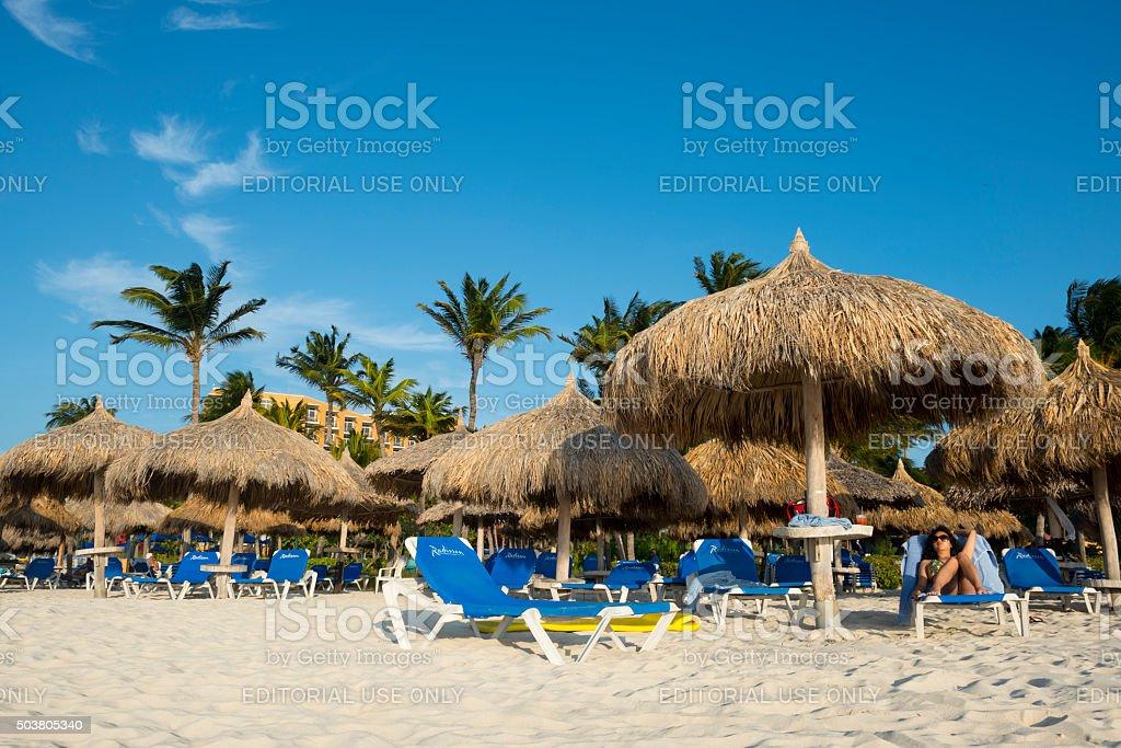 Sunbathing on Palm Beach, Aruba stock photo