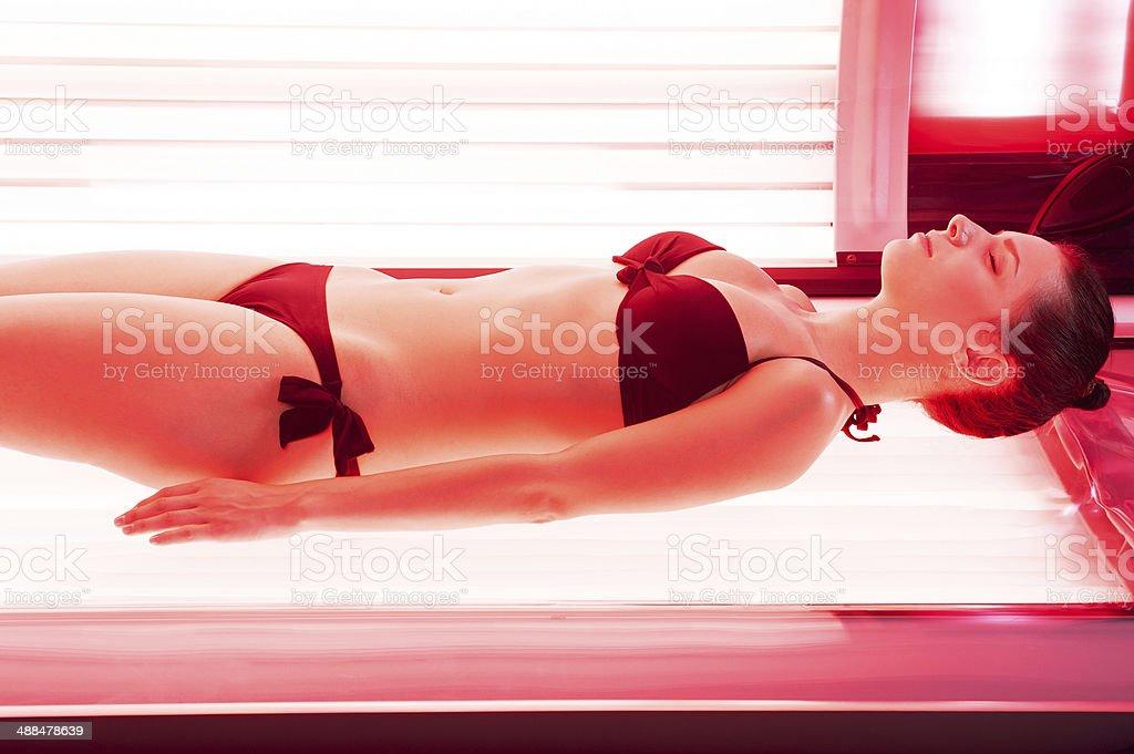 Sunbathing on tanning bed. royalty-free stock photo