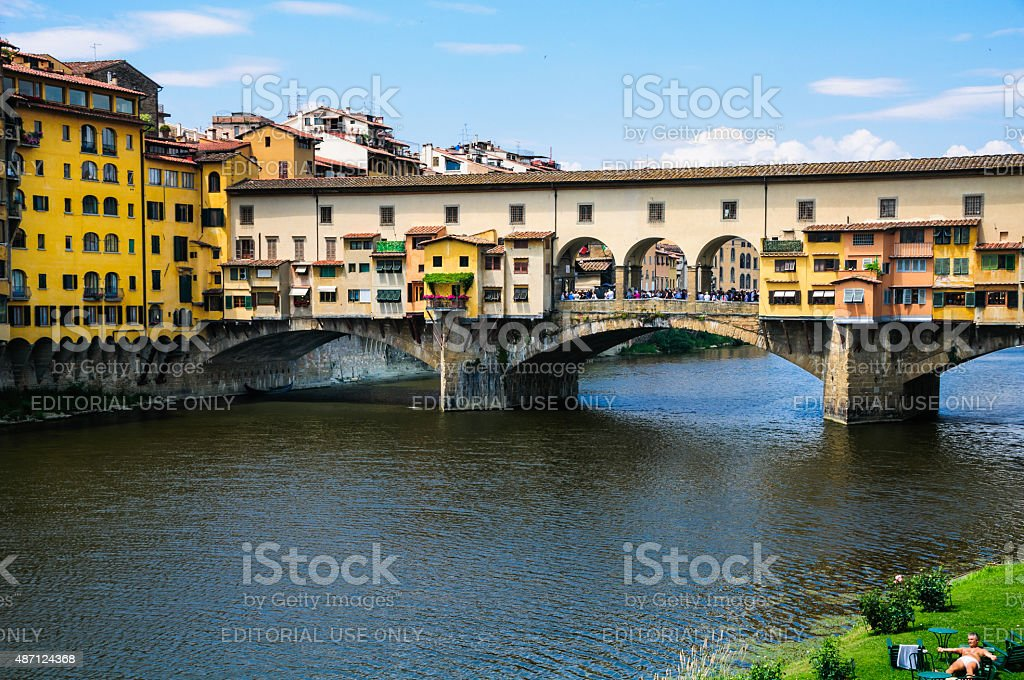 Sunbathing on the Arno stock photo