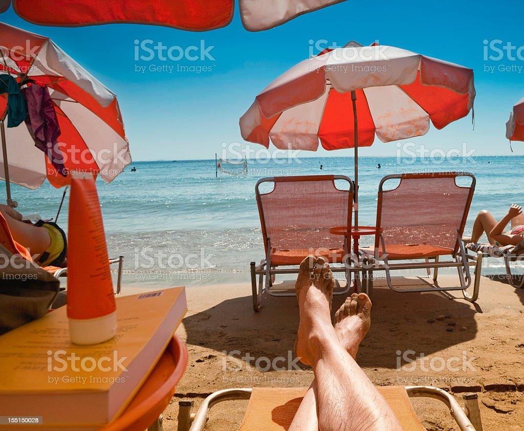 Sunbathing on the beach royalty-free stock photo