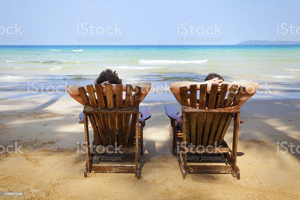 sunbathing on the beach stock photo