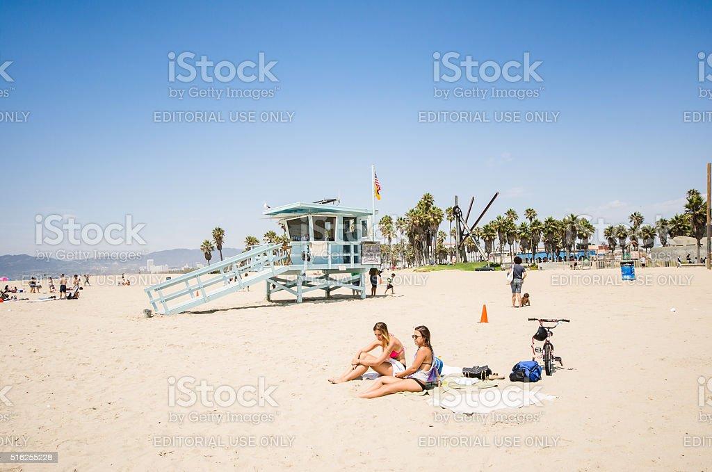 sunbathing on venice beach stock photo