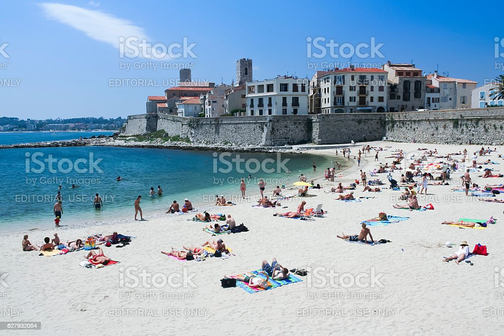 sunbathing people antibes city beach france royalty-free stock photo