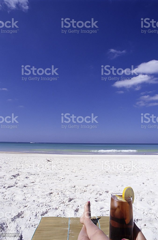 sunbathing with a cool drink stock photo