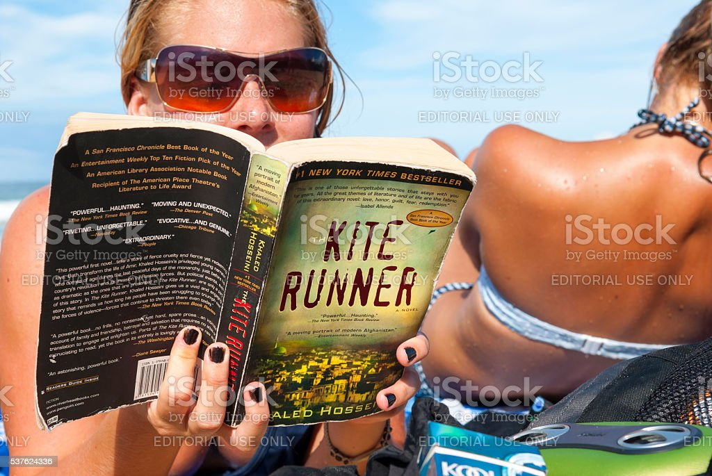Sunbathing with the Kite Runner in Bocas del Toro, Panama stock photo