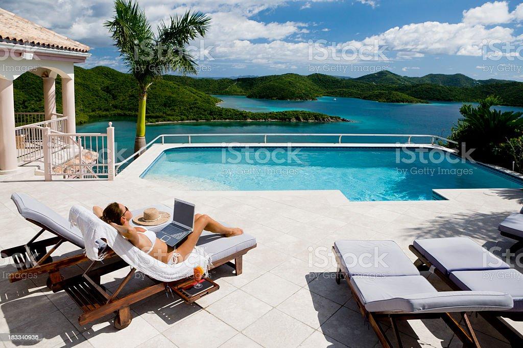 sunbathing woman on luxury vacation in the Caribbean stock photo